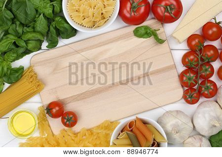 Ingredients For A Spaghetti Pasta Noodles Meal On Cutting Board With Copyspace