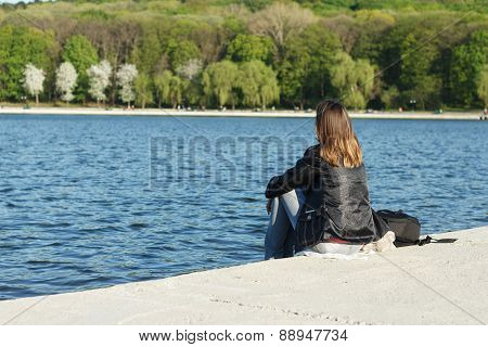 Girl Meditates On Bank