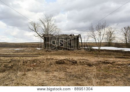 Destroyed wooden house in the deserted village