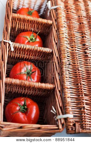 Four Tomatoes In Wicker Box