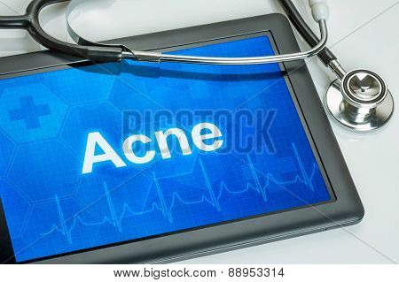 Tablet With The Diagnosis Acne On The Display