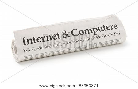 Rolled Newspaper With The Headline Internet And Computers