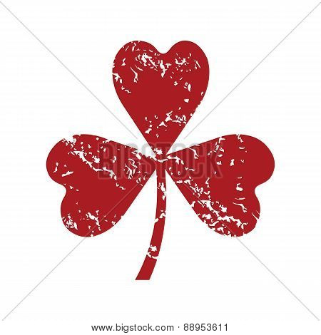 Red grunge shamrock logo