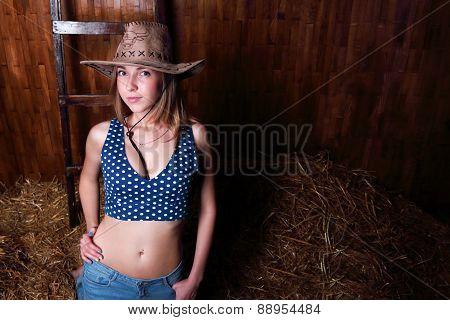 Closeup Of Beautiful Smiling Girl With Long Blond Hair Wearing Cowboy Hat