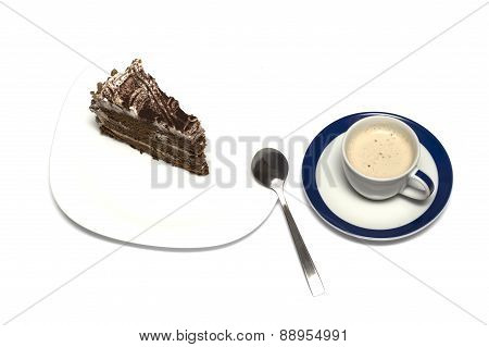Mug Of A Cappuccino And Chocolate Cake With A Tea Spoon