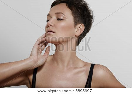 Woman Touching Her Ideal Skin