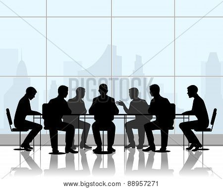 Businessmen At Negotiating Table