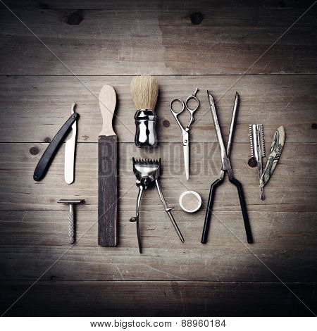 Vintage Equipment Of A Barber On Wood Background