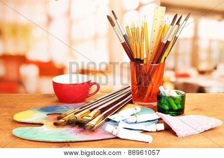 Artistic equipment paint, brushes and art palette