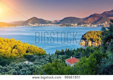 Fantastic view azure sea over Budva riviera in Montenegro. Dramatic morning light. Balkans, Adriatic sea, Europe. Beauty world.