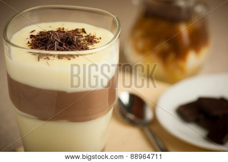 Mixed Chocolate And Vanilla Pudding Served In A Glass Decorated With Chocolate Pieces