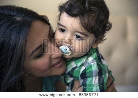 Happy Mother With Child. Selective Soft Focus Effect