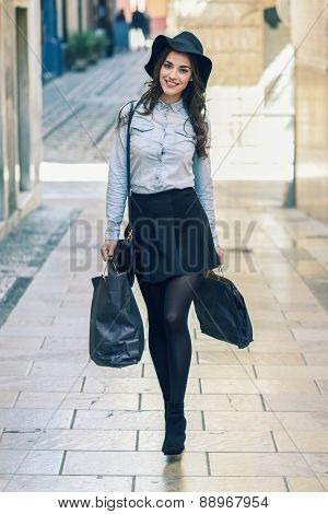 Woman Walking On The Street With Shopping Bags