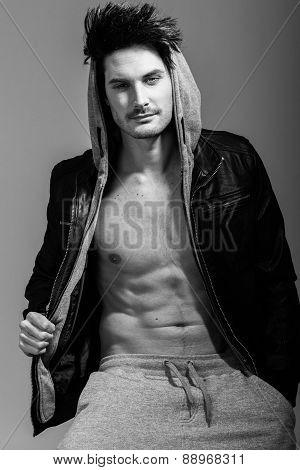 Athletic Man Wearing Hoodie Jacket. Studio Shot