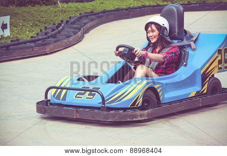 Cute Thai Girl Is Driving Go-kart In Vintage Color