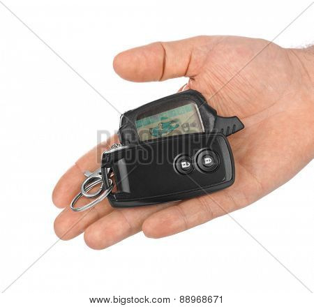 Hand with car keys isolated on white background