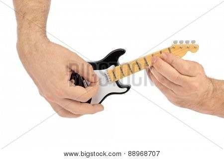 Hands and toy electric guitar isolated on white background