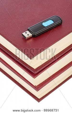 Books and flash memory isolated on white background