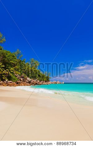 Tropical beach at island Praslin Seychelles - vacation background