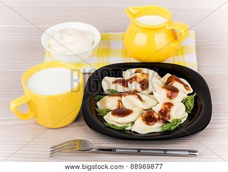 Dumplings On Plate, Mayonnaise, Towel, Jug And Cup Of Milk