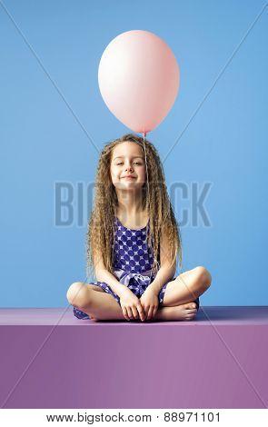 Happy little girl with balloon