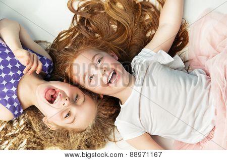 Happy kids lying on white background