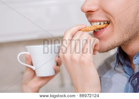 Guy is being fed cookie by lady