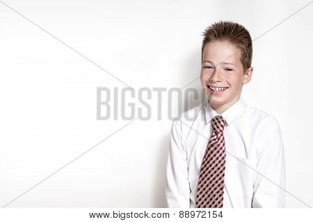 Emotional portrait of smiling boy with tie
