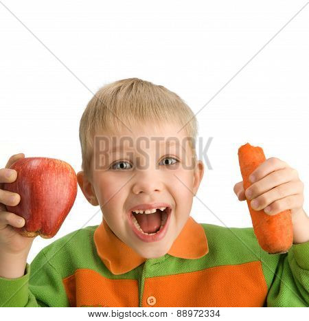 Happy Little Boy Biting Apple And Carrot