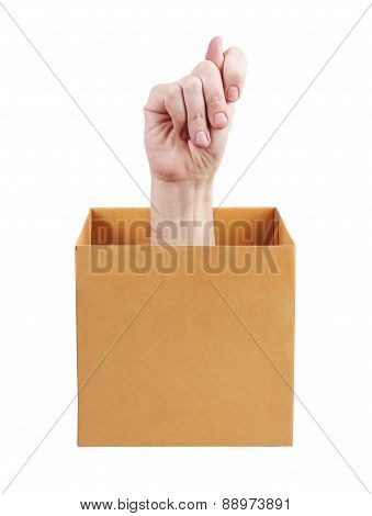 Human Hand Sticking Out Of A Box
