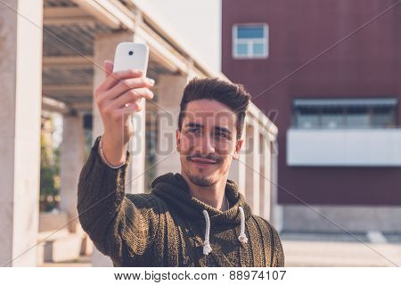 Young Handsome Man Taking A Selfie