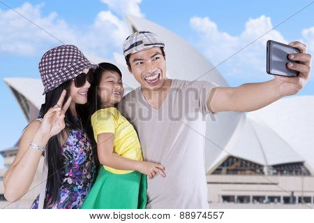 Family Taking Selfie Photo At Opera House