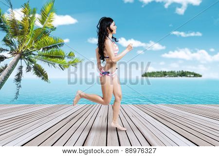 Happy Woman Running On The Pier