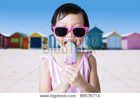 Kid Eats Cold Ice Cream At Shore