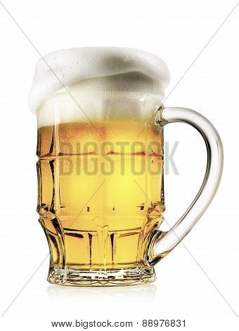Faceted mug of light beer with foam