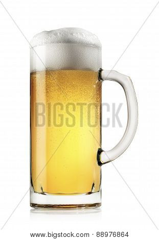 Mug of fresh light beer with foam