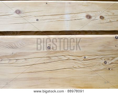 Fragment Of A Wall From Wooden Logs As Background