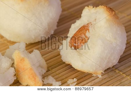 Coconut cookies as balls on bamboo background