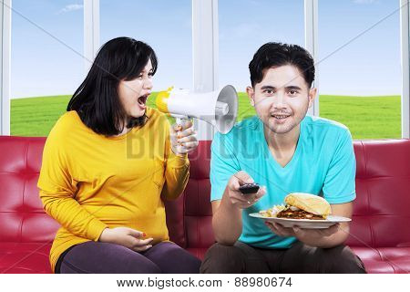 Wife Shouting At Her Husband At Home