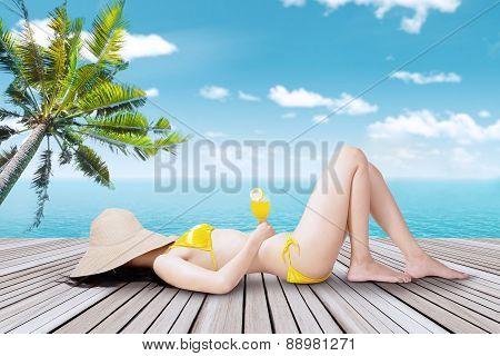 Woman With Bikini Lying On The Pier