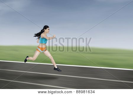 Young Athletic Woman Running