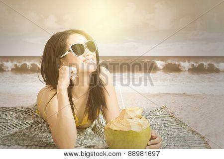 Young Model Lying At Coast