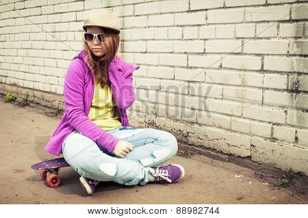 Blond Stylish Teenage Girl In Jeans And Sunglasses
