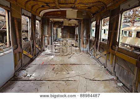 Abandoned train carriage with interior falling apart