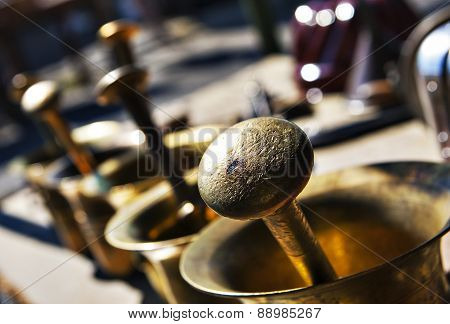 Brass Mortars Outdoors At A Market Stall For Sale