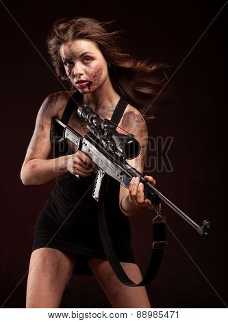 Sexy military woman posing with sniper gun.
