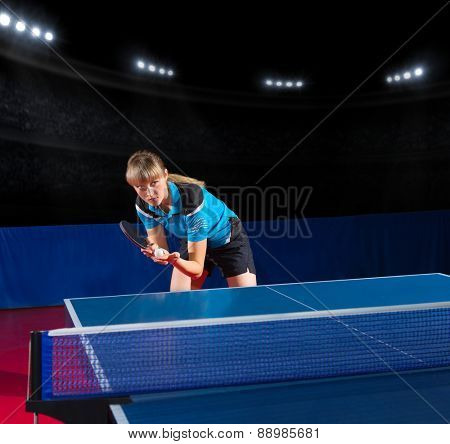 Young girl table tennis player at sports hall