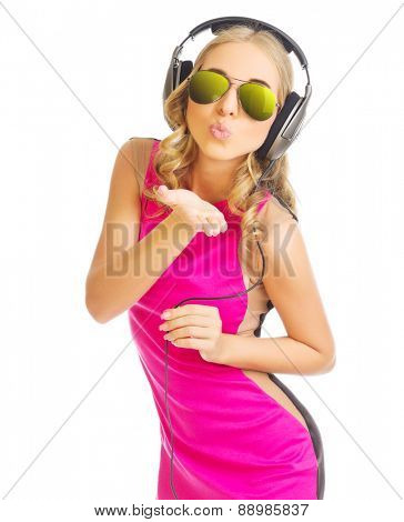 Young girl in red dress with headphones isolated