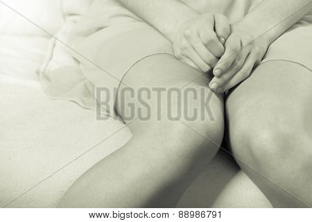 Woman Sitting On Couch, Female Legs