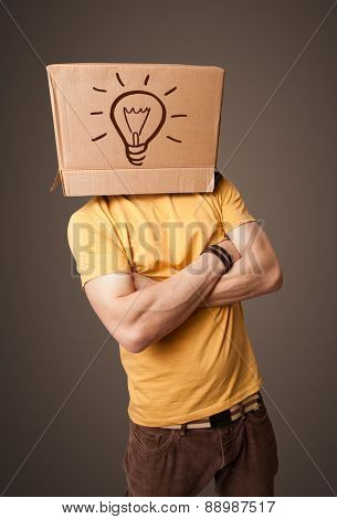 Young man standing and gesturing with a cardboard box on his head with light bulb